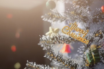 Christmas Composition. Christmas tree decorate with red bell, light bulb  and blurred background. Decorations for Christmas, winter, new year concept. Merry christmas party. Front view. Copy space.