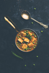 Green peas or matar paneer curry recipe, served in a bowl. selective focus