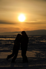 Couple dance Tango in Sunset on Ice of Lake Baikal