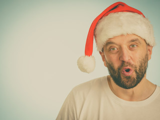 Surpriced man in santa claus hat