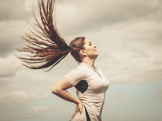 Fit woman having windblown hair
