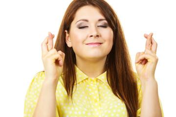 Woman keeping her fingers crossed
