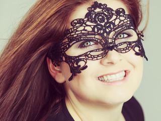 Mysterious woman wearing lace mask