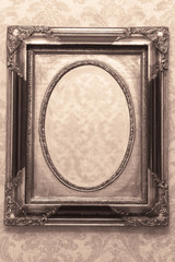 Vintage mirror without reflection. Old mirror in a carved frame. Retro style in the interior. A terrible phot from a horror movie. Empty antique frame.