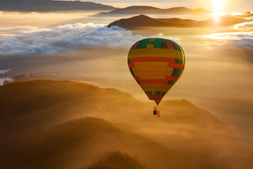 Printed roller blinds Balloon hot air balloon flying over misty mountains at sunrise - freedom and travel concept