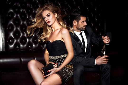 Sexy elegant couple. Beautiful woman near the man.
