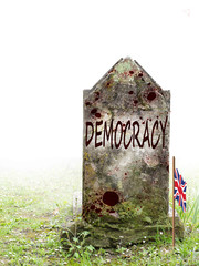 Democracy is dead, UK EU referendum politics. Ancient gravestone in fog, with blood and bedraggled Union Jack flag.
