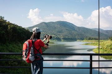 Asian woman travels take a photograph