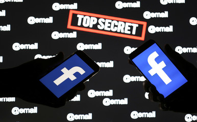 "Persons hold smartphones with the Facebook logo in front of displayed ""top secret"" and ""email"" words in this picture illustration"