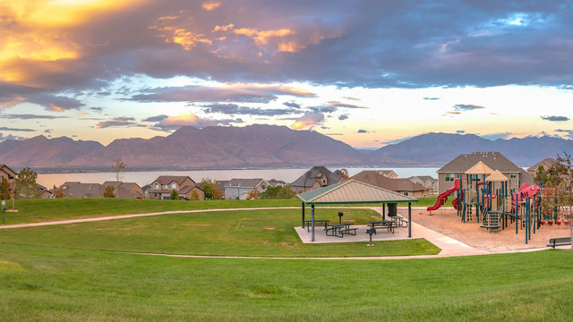 Homes and playground with lake and mountain view