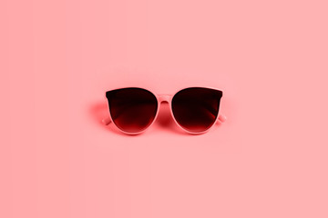 sunglasses isolated on a living coral background