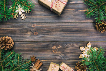 Wall Mural - Christmas vintage, toned background with fir tree and gift box on wooden table. Top view with copy space for your design