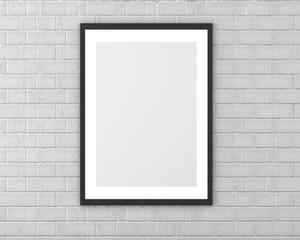 Mock up blank black frame on white brick wall