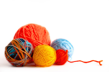 Balls of yarn for knitting on a white background. Macro. Multi-colored yarn for knitting on an isolated white background. Needlework in the form of knitting.