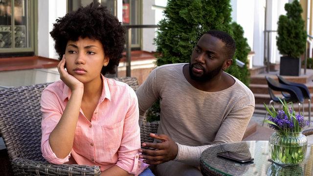 Upset offended girl ignoring boyfriend, turned away, misunderstanding, conflict