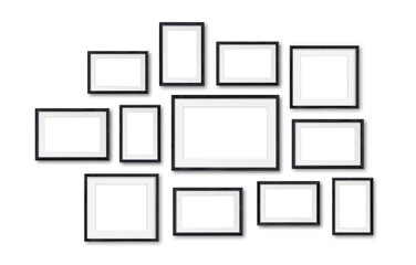 Photo frames collage , twelve black wooden frameworks isolated on white  wall