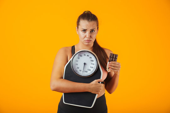 Portrait of an upset overweight young woman
