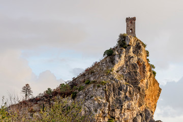The Upezzinghi tower in Caprona against a dramatic sky, Pisa, Tuscany, Italy
