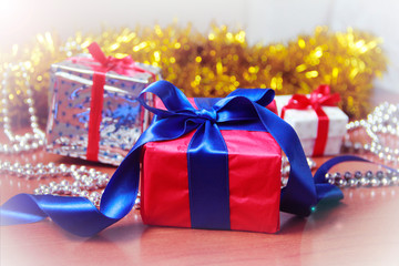 New Year's Christmas multicolored boxes with gifts and toys for the Christmas tree on a yellow shiny background