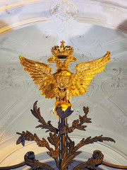 Two headed eagle, decoration of a forged gate in Winter Palace, the Hermitage Museum at Saint Petersburg, Russia. Night illumination