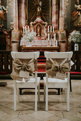 two chairs in church at a wedding