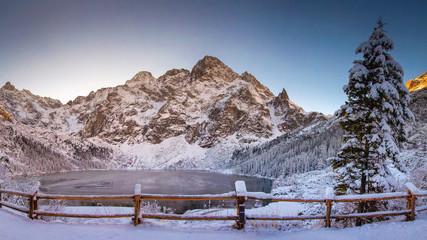 Fototapeta Winter mountains with icy lake Sea Eye in Tatra national park. Morskie oko landscape obraz