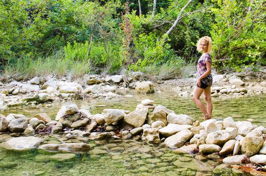 Young woman walking in Barton Creek Greenbelt in Austin, Texas