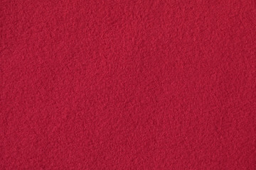 Texture of red fleece, soft napped fabric
