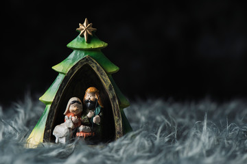 the holy family on a gray artificial fur