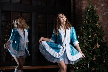 Christmas characters Snegurochka. Girls in Christmas costume posing in the Studio