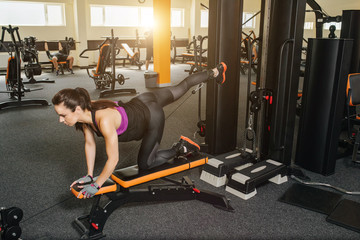 Fitness woman doing lunges exercises for leg muscle and buttocks workout training in gym.