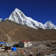 Hotels in Gorak Shep, last place before the Everest Base Camp. Snow capped Mount Pumori 7161 m and Kala Patthar.