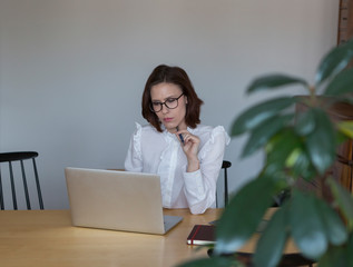 Businesswoman Using Laptop While Working From Home