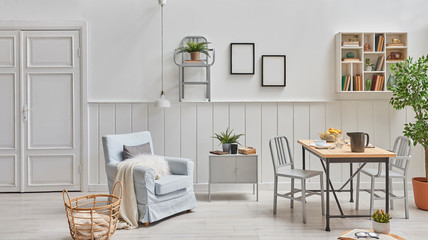 Modern decorative room, white wall background, metal chair concept on the wall and wooden decorative table with vase of plant.