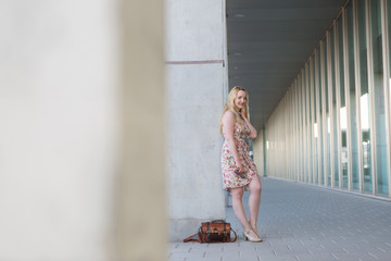 Attractive blond woman waiting in town