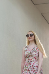 Attractive stylish woman in a summer dress