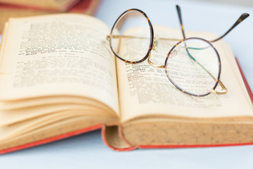 Pair of reading glasses on an open book