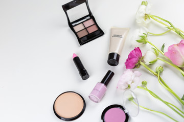 Cosmetics and make-up still life on white