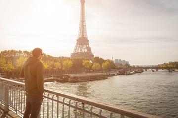 Man Enjoying The View Of Eiffel Tower From Bridge
