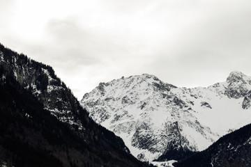 Snow covered alpine peak on a gloomy winter day