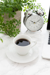 Coffee Cup Alarm Clock Laptop And Plants On Table