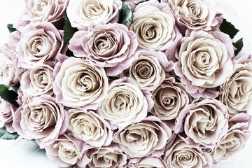 Bouquet of fresh pink roses . Vintage style photo.