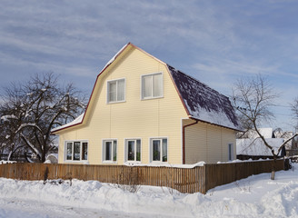 Country house with siding in winter
