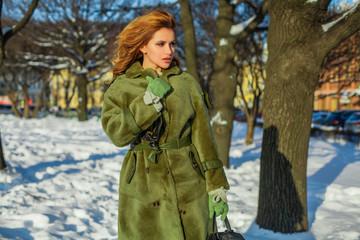 Fashion model woman in warm winter coat, romantic portrait