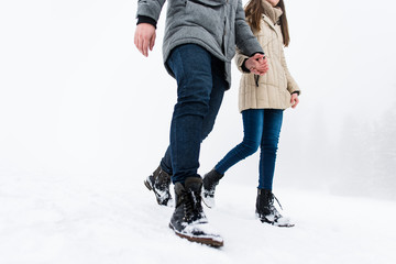 Couple holding hand in hand, cropped image.