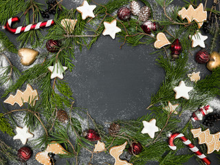 christmas wreath on black background with many different christmas items