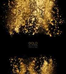 Scattered gold glitter powder on black background. Golden powder explosion