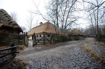 View of rural street and Ukrainian traditional rural household at Mamaeva Sloboda, Ukraine