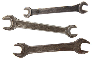 three old rusty wrench tools isolated on white background