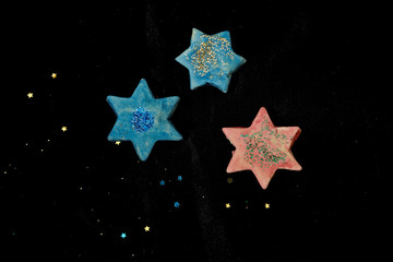 Blue and pink ceramic stars with black background